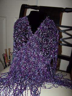 Hand Knit Shawl Triangle in Shades of Purple Ladder Ribbon Yarn. $50.00, via Etsy.