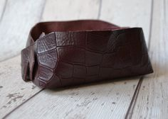 A personal favourite from my Etsy shop https://www.etsy.com/uk/listing/279250198/croc-leather-jewellery-tray-trinket-tray