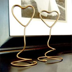 Gold wire picture holders as part of the centerpieces?