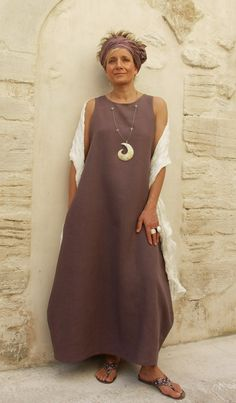 Linen dress  lavender color.  she.is.stunning. love the headband ... wish i could wear one and not look silly.