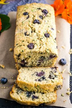 This is THE zucchini bread that melts in your mouth and makes you crave your next bite. Fresh blueberries, a wheat/white flour blend, and half the sugar of a classic zucchini bread recipe makes this gem slightly sweet and desirably healthy. We should just call this the hallelujah zucchini bread recipe...or even blueberry bread. No joke...you'll see! Each bite explodes with juicy blueberries with the perfect hint of lemon! | The Kitchen Girl @thekitchengirl #healthyblueberrybread #thekitchengirl Classic Zucchini Bread Recipe, Blueberry Zucchini Bread, Zucchini Bread Recipes, Beef Recipes, Vegetarian Recipes, Snack Recipes, Muffin Recipes, Easy Recipes, Breakfast Recipes