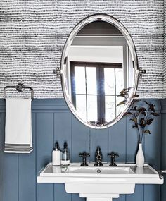 Black and white powder room wallpaper is lined with a blue shiplap trim fixed behind a white pedestal sink mounted under an oval pivot mirror. Navy Bathroom Decor, Shiplap Bathroom, Bathroom Colors, Bathroom Flooring, Master Bathroom, Bathrooms Decor, Downstairs Bathroom, Bathroom Ideas, Powder Room Wallpaper