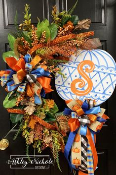 Adorn your door this Fall with this classy pumpkin wreath! Pumpkin is made of thick wood. Painted on the back for a polished look. made on a 24 natural grapevine Fall Door Decorations, Halloween Decorations, Halloween Wreaths, Mickey Halloween, Halloween Halloween, Vintage Halloween, Halloween Makeup, Halloween Costumes, Thanksgiving Wreaths