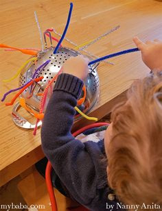 pipe cleaner and colander activity for toddlers to help develop their fine motor skills. Indoor Activities For Toddlers, Gross Motor Activities, Sensory Activities, Infant Activities, Nursery Activities, Funky Fingers, Early Childhood Activities, Baby Sensory, Sensory Play