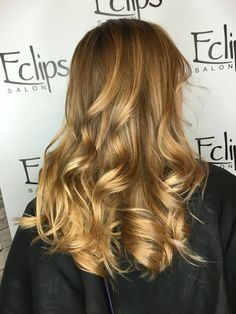 Stylist Cassidy's client loved her natural ombré but was disappointed when her hair started to naturally reclaim its depth. We painted a few highlights in her ends for that natural sun-kissed look! Reserve today: (703) 327-9408 or visit http://eclipsashburn.com