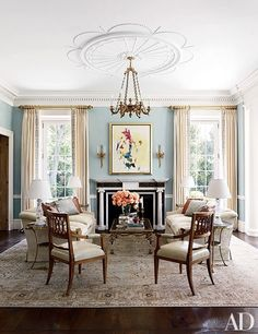 A circa-1920 Tabriz carpet from Galerie Shabab brightens the living room of a Houston home decorated by Cullman & Kravis | archdigest.com
