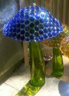 Mushroom made with Glass gems glued onto a bowl. Maybe try red with white gems for a spotty mushroom