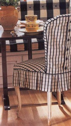 Pleated skirt on fully slipped chair with button detail