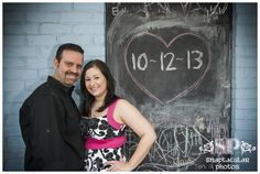 During Jessica and Paul's engagement session, we took advantage of a chalkboard in Old Town Spring to share their wedding date. Too cute!    |www.snaptacularphotos.com|