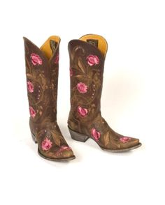 Women's Julie 4L Toe Boot - Brass  $570.00 - Artisan handmade Old Gringo Julie cowgirl boots Intricate pink floral embroidery bedecked in shimmering pink acrylic rhinestones Leather upper, lining, insole, heel, & sole Tinting, abrasions, & scarring on leather add vintage boot character Hand-driven lemonwood pegs