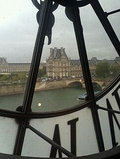 Paris on a Tuesday-the Louvre via the clock face of the D'Orsay
