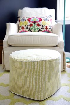 Nursery/Baby's Room: Ballard Designs Larkin Rocker, round ottoman with DIY Slipcover, Yellow and White trellis rug, Hale Navy Benjamin Moore Paint, Waverly Santa Maria Desert throw pillow
