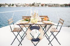 For an intimate yacht elopement, add some nautical details to your table.