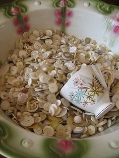 When I was little, I would play with my Mom's buttons.  Some of them were so pretty.
