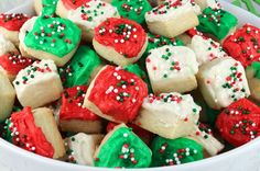 Christmas Sugar Cookie Bites - these yummy Christmas Treats are so easy to decorate that even the youngest family member can join in on the fun. They are a super delicious bite-sized taste of sugar cookie and creamy buttercream frosting. You'll definitely want to add these Christmas Cookies to your Christmas Baking List this year! Pin this colorful and festive Christmas dessert for later and follow us for more great Christmas Food Ideas.