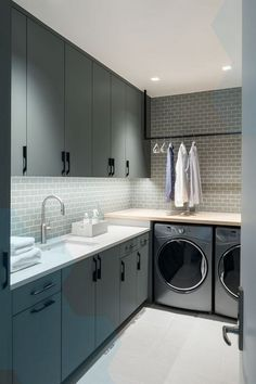 ULTRA-MODERN This laundry room from Duet Design Group uses a creative, neutral color palette to achieve its high-impact, minimalist aesthetic. Elegant Laundry Room, Home, Laundry Design, House, Utility Rooms, Room Design, Room Decor