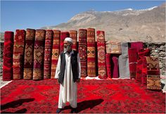The Pamir Mountains of Tajikistan: An Afghan carpet trader at the market in Iskashim | Photo by Andy Isaacson | The New York Times