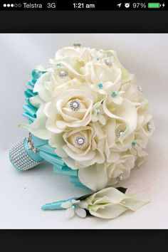 Flowers with teal, pearls and bling