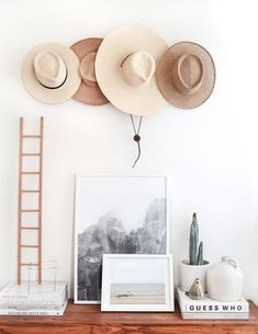 Hats on the wall, hats, garden hats, organization, idea, decor, functional decor, hooks, organizing with hooks, inexpensive decor ideas, design, simple, clean, minimal, white, and light