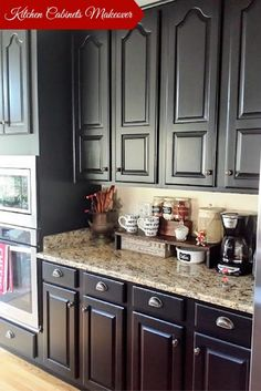 Painted kitchen cabinets with General Finishes Lamp Black Milk Paint and D. Lawless Hardware