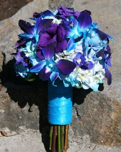 Gorgeous Wedding Bouquet Featuring: White Hydrangea (Tinted Blue), Blue/Purple Dendrobium Orchids & Purple Lisianthus Hand Tied With A Blue Ribbon