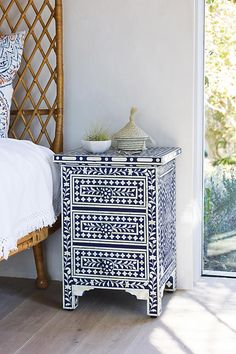 I'm not crazy about the nightstand itself, but I would love this kind of tile pattern in the bathroom