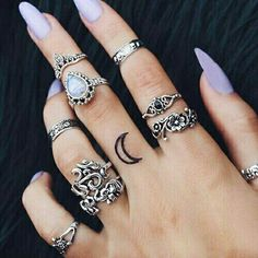 Pastel lilac nails with rings