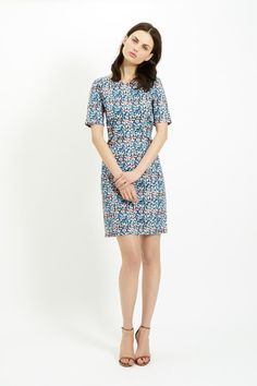 Multi coloured dress with floral print in 97% certified organic cotton, 3% elastane. Above elbow length sleeves & invisible back zip. Length 96cm.