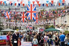 Royal party: Some 10,000 people are estimated to be in attendance, including Prince Philip and the Queen's grandsons William and Harry. Pictured, revellers turn out for the Queen's Diamond Jubilee street party