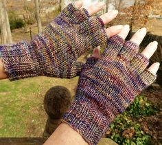 Half finger ladies gloves are handknit in multicolored, variegated 51% silk and 49% merino wool. These womens half finger gloves are knit with ribbing at the wrist for a close, warm fit, and smooth stockinette stitch throughout the rest of the glove for a classic, tailored look. The fabric is unbelievably soft (merino wool is known for its softness), durable and exceptionally warm. The silk content also adds an elegant sheen to the buttery soft fabric.  This style of ladies glove includes a…