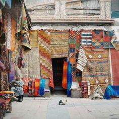 Traditional Moroccan textiles hanging outside in the market. (No link)