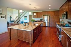 This kitchen features abundant storage space, and miles of counters to prepare meals and entertain.