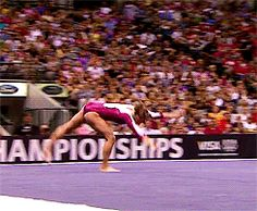 I love how Bridget does her 3/2! Since she waits until the last moment to separate her legs, it looks very clean and just propels her into her roundoff. (gif)