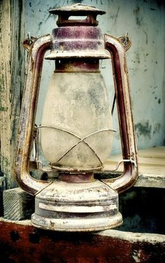 Old oil lamp - hang a couple off a surf shack/ yurt wall, have one additional propped on a crate