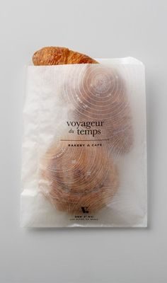 Voyageur Du Temps Branding by Character. I like the use of the white patterns over a transparent substrate.