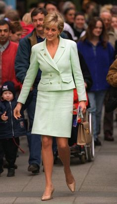Princess Diana recycles this lovely pale mint green outfit on two occasions, seen above, 1997