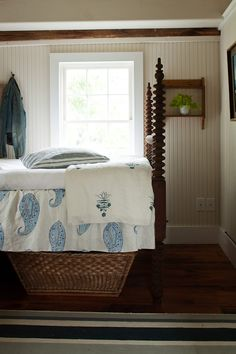 four post bed, print, pattern, paisley, white, blue, clean, wainscotting, white washed, basket, storage, turned, wood, bedroom, cozy, cottage style, potted plant, green, fresh, woven, crisp, striped, rug, shelving, foliage, hooks from: laurenliess