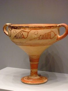 A Mycenaean stemmed cup (1350-1300 BCE) in terracotta and depicting stylized seashells. (The Getty Villa, Malibu, USA).