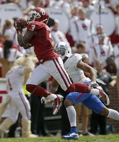 OU 51 - TU 20. Oklahoma's Sterling Shepard (3) catches a touchdown pass n front of Tulsa's Dwight Dobbins (9) during a college football game between the University of Oklahoma Sooners (OU) and the Tulsa Golden Hurricane at Gaylord Family-Oklahoma Memorial Stadium in Norman, Okla., on Saturday, Sept. 14, 2013. Oklahoma won 51-20. Photo by Bryan Terry, The Oklahoman.