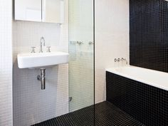 desire to inspire - desiretoinspire.net - Stalking new oldapartments - white and black bathroom with white mosaic tile