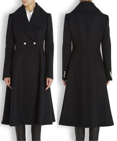 November 9, 2014 - The coat features Kate's favorite silhouette, a fit and flare design with a full skirt. It also has oversized notched lapels, side slit pockets, and a double-breasted closure above the natural waist.  Harvey Nichols