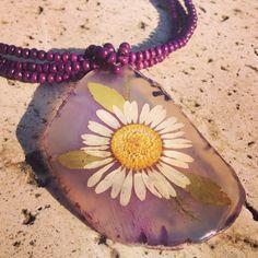 Press flower as a pendant.