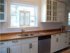 mosaic backsplash kitchen kitchen remodel we used butcher block counter tops 4283
