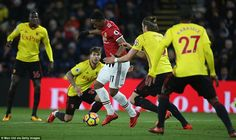 Anthony Martial is crowded out by Watford players as he looks to keep the momentum with Manchester United