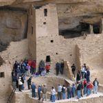 Visitors encircle a kiva at Cliff Palace