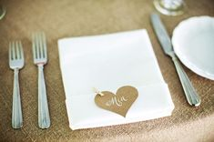 A heart cut out of brown paper and pegged to your napkins to make a pretty place name.