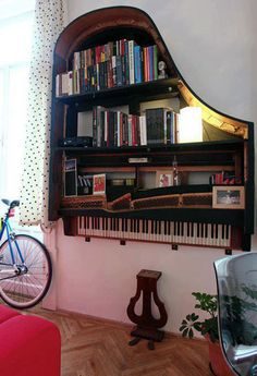 """Musical Decor & Inspiration via Apartment Therapy: good use for what my mom calls """"piano shaped objects""""--pianos so old and neglected that they become irredeemably unlistenable."""