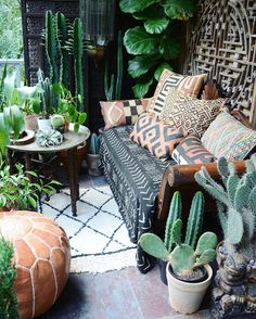 happy weekend! -- from my tiny balcony🌿💚🌿XX -- malian mudcloth, kuba cloth (congo) pillows, moroccan pillow, moroccan beni ourain rug, moroccan tray table, plants, moroccan pouf, chinese window frame, indian lantern, chinese foo dog