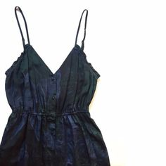 """UO Ecoté Silk Printed Slip Dress Button down Ecoté dress. 100% Silk. Black, green, blue. Almost feathery tribal print on the dress. Great used condition. No noticeable wear. Pockets! For your tots or a very, very small cat or something. I can't tell you what to put in your pockets. I'll try, but ultimately that's up to you.   Bust: 32-34"""" Waist: 22-30"""" Length: 32"""" Ecote Dresses Mini"""