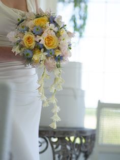 Pastel yellow and blue wedding bouquet - shot on location here